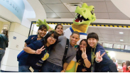 Photo of student with mascot.
